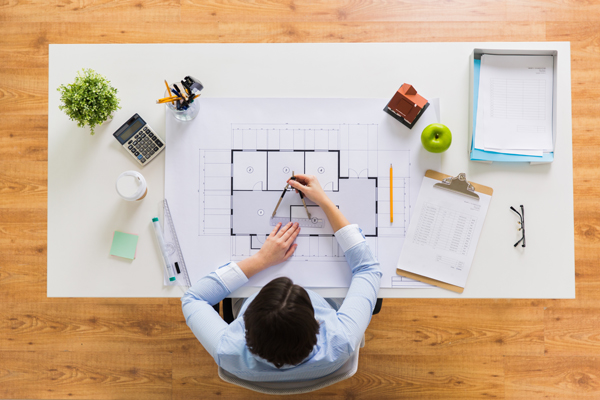 architects cork-business, architecture, building and construction concept - architect woman with compass measuring blueprint of living house at office